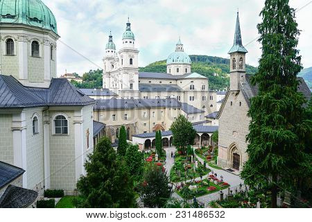 Salzburg, Austria - September 6 2017; View Through Window To Buildings, Church Domes And Cemetery Be