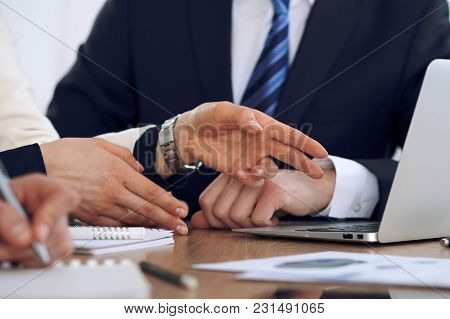 Group Of Business People Or Lawyers  At Meeting, Hands Close-up.
