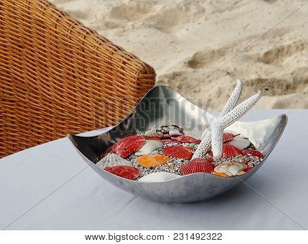 Tropical Wedding Decoration With Starfish And Shellfish On A White Table On The Beach