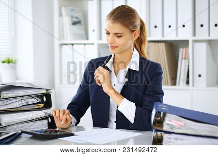Modern Business Woman Or Confident Female Accountant In Office. Student Girl During Exam Preparing.