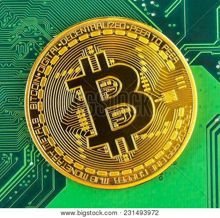 Bitcoin Concept - Gold Coin, Computer Circuit Board With Bitcoin Processor And Microchips.