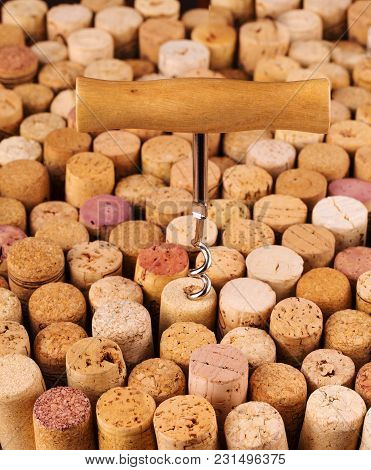 The Old Corks On Wooden Table Background.