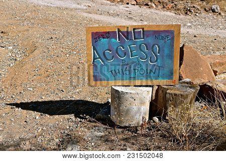 Homemade Chalk Board Sign Established Boundaries In A Rural Gravel Setting