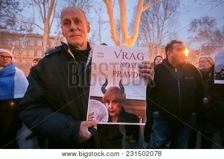 Zagreb, Croatia - 3rd March, 2018 : Man Holding A Sign With Portrait Of Judge Maja Supe Looking Like