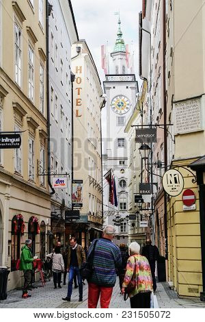 Salzburg, Austria - September 6 2017;  Street Scene, People Walking Along Narrow Road Between Restau