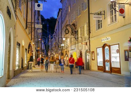 Salzburg, Austria - September 6 2017;  Street Scene,blurred  People Walking Along Narrow Road Betwee