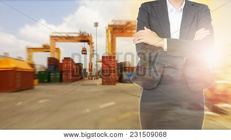 Business Woman With Container About Import And Export Ship Port Background.
