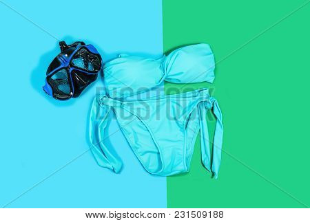 Bikini And Glasses For Snorkeling On Green And Blue Background.