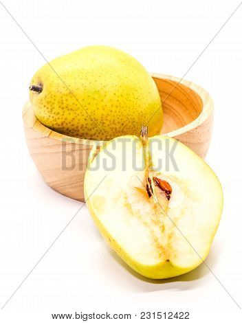 Closeup Of Yellow Fresh Ripe Organic Pears On Brown Wooden Cup And Half Pear