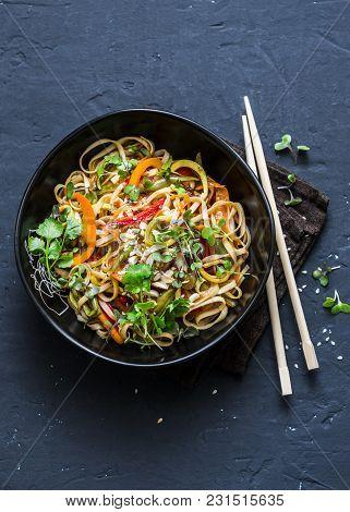 Pad Thai Vegetarian Vegetables Udon Noodles In A Dark Background, Top View. Vegetarian Food In Asian