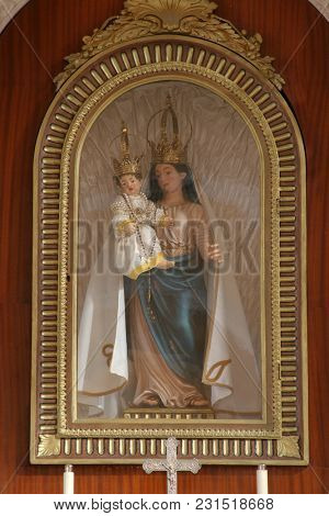 SMOKVICA, CROATIA - MARCH 21: Virgin Mary with baby Jesus statue on the Our Lady altar in the Church of Blessed Virgin of Purification in Smokvica, Korcula island, Croatia, on March 21, 2017.
