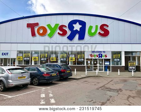 LONDON - MARCH 16, 2018: Closing down price reduction banners at Toys R Us following the liquidation of the company chain in Brent Cross, North London, UK.