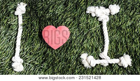 I Love I Transcription Made From Ropes On Grass Background
