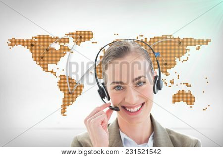 Digital composite of lady with headset against world map