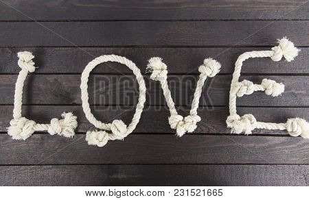 Forming The Word: Love With Rope On Wooden Background