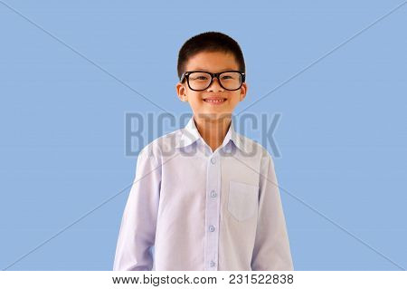Handsome Asian Kid Wear Eye Glasses With Smile Face Selective  Focus Isolated On Light Blue Backgrou