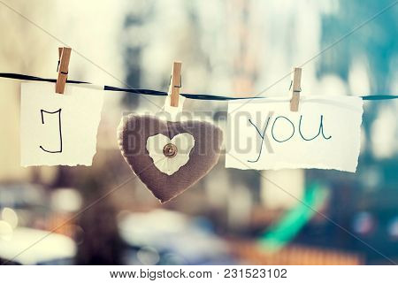 I Love You vintage background. Heart and note with words