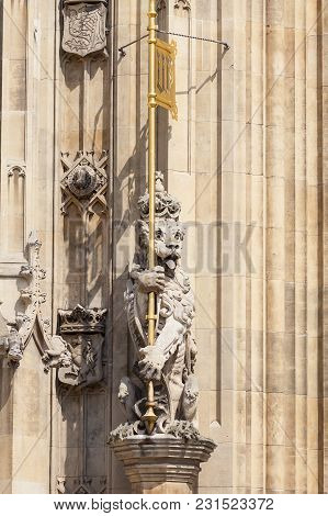 Palace Of Westminster, Parliament, Statue Of Stone Lion On Facade, London, United Kingdom, England.
