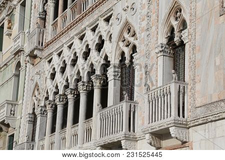 Venice, Italy - December 31, 2015: Fabulousness Architectonic  Detail  Of An Ancient Palace Called C