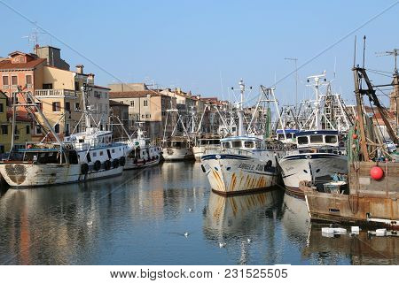 Chioggia, Ve, Italy - February 11, 2018: Many Fishing Boats Moored In The Industrial Port