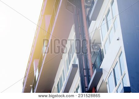 Apartment Building With Tone Of Vintage Under Blue Sky.