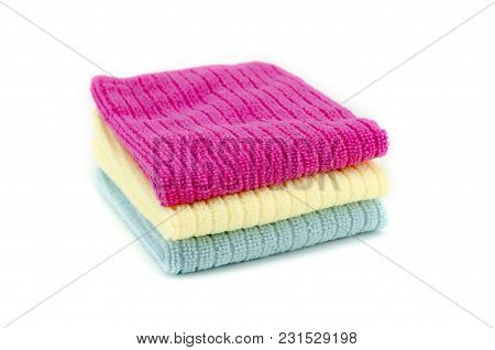 Pile Of Neatly Folded Colorful Cotton Towels In Red,yellow And Blue Color Isolated On White Backgrou