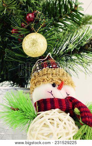 Horizontal View Closeup Image Of Santa Claus, Golden Ball, Purple Gift Box,  And Christmas Tree Isol