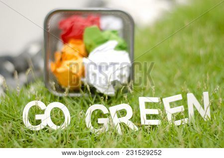 Blurred Image Of Crumple Paper In Thrash Can With Alphabet Go Green On Green Grass