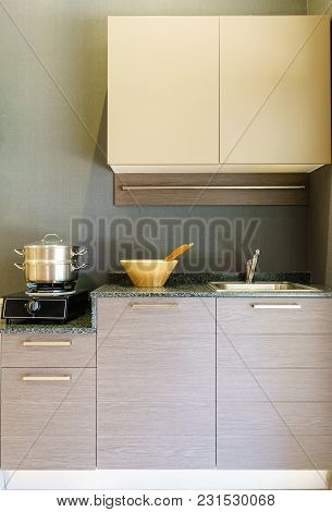 Close-up Of Stainless Steel Cooking Pot On Induction Hob In Contemporary Modern Home Kitchen.