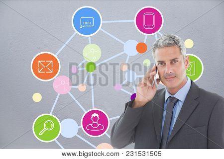 Digital composite of business man talking on phone