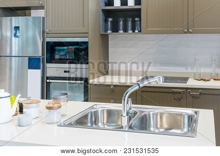 Modern, Bright, Clean Kitchen Interior With Stainless Steel Appliances In A Luxury Apartment.