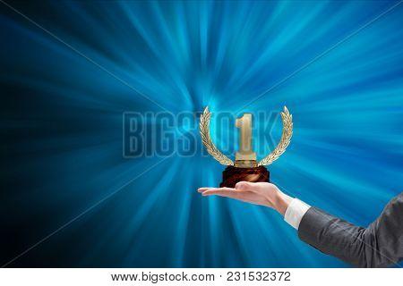 Digital composite of holding trophy