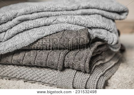 Plaid Textured Gray Stacked In A Pile