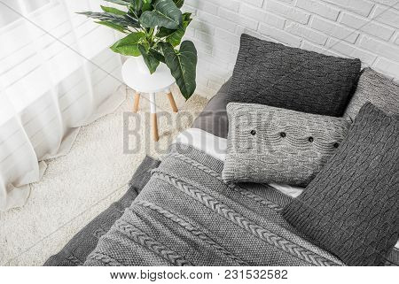 Bedroom Interior Bed In Gray Tones With Flower On Bedside Table And Dekor
