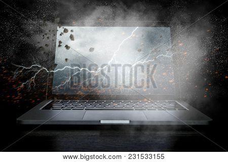 Opened laptop on dark background. Mixed media