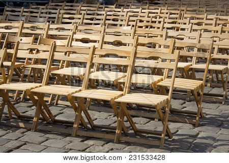An Outstanding Event Under The Open Sky, Wooden Chairs On The Streets Of The City In A Row