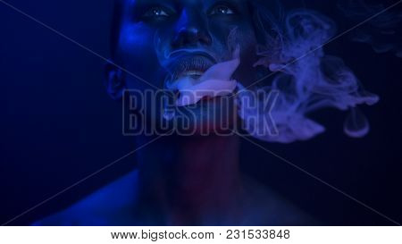 Halloween Vape Party - Nightlife. Beautiful Sexy Young Woman With Glamorous Mystical Makeup Vaping I