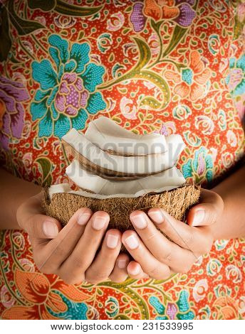 Woman Hand Holding Tropical Coconut Fruit Stack With Colorful Background