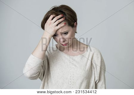 Young Pretty And Sad Red Hair Woman Looking Worried And Depressed Crying And Suffering Headache And