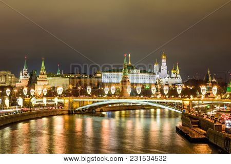Moscow, Russia - January 2, 2018: Illuminated Moscow Kremlin And Moscow River In Winter Evening.