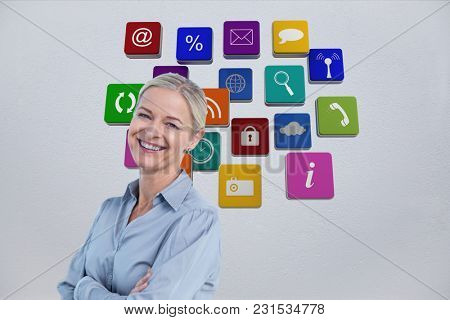 Digital composite of smiling business woman against background of 3D assets
