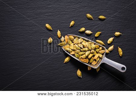 Healthy Food Concept Aroma Spice Dried Cardamoms On Black Slate Background With Copy For Text