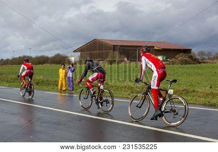 Cernay-la-ville, France - March 5, 2017: Three Cyclists Of Team Cofidis (caleys, Bouhanni, Lemoine)
