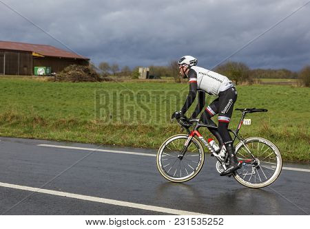 Cernay-la-ville, France - March 5, 2017: The Dutch Cyclist Roy Curvers Of Team Sunweb Riding On A We