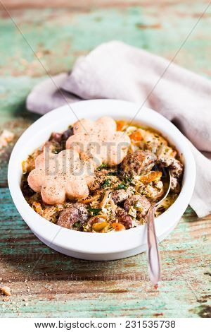 Ragout With Chicken Liver, Mushrooms, Carrot, Onion And Sour Cream Served With Cheese Scones In A Ba