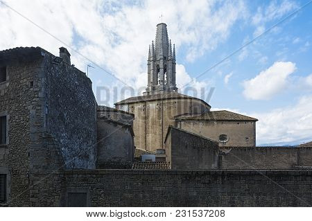 Spain, Girona - 09/18/2017: Ancient Architecture Of The Historic Part Of The City And The Bell Tower