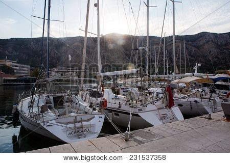 Kotor, Montenegro - September 24: White Yachts Stand On The Pier In The Fall In The City In The Euro