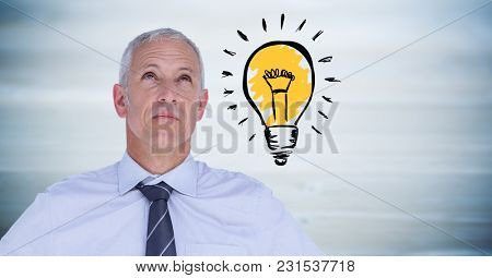 Digital composite of Business man thinking with light bulb doodle against blurry blue wood panel