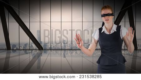 Digital composite of Business woman blindfolded against window and skyline