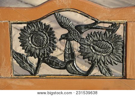 Sunflowers And A Bird, Forged From Metal In An Old Wooden Frame On The Back Of An Old Chair